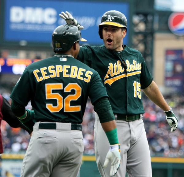 Oakland's Seth Smith, right, celebrates his two-run home run with teammate Yoenis Cespedes.