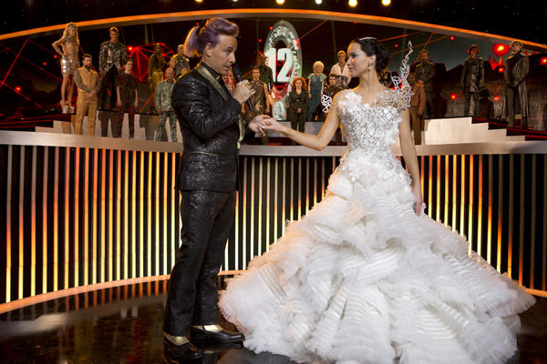"Caesar Flickerman (Stanley Tucci) and Katniss Everdeen (Jennifer Lawrence) in the upcoming movie ""The Hunger Games: Catching Fire."""