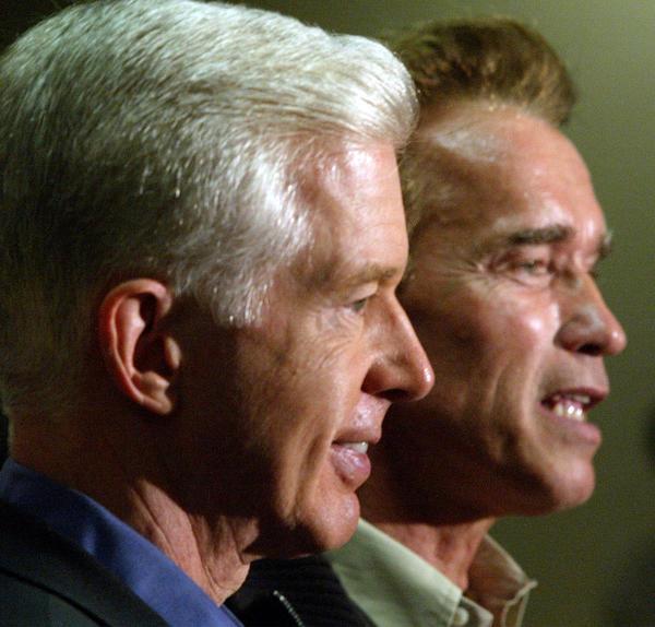 Former California Gov. Gray Davis, left, and his successor, actor Arnold Schwzarzenegger.