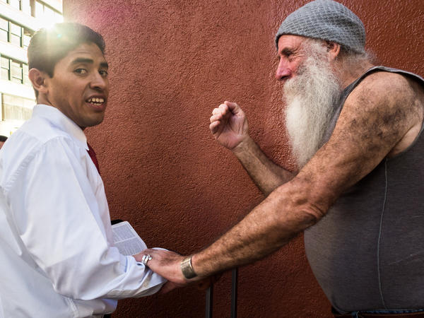 Two men have a religious debate in downtown Los Angeles.