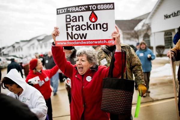 Annette McMichael, center, and other opponents of hydraulic fracturing, or fracking, an oil extraction technique, stage a March protest in Springfield.