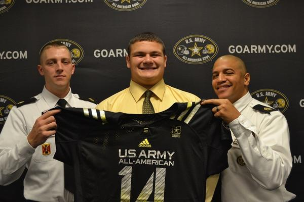 Army Representatives Sergeant Stephen Goeke (left) and Sergeant First Class Brian Jones (right), surround Lincoln-Way East's Nick Allegretti.