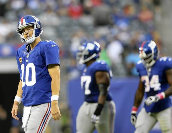 Giants quarterback Eli Manning (10) walks off the field after throwing an interception in the fourth quarter against the Philadelphia Eagles at MetLife Stadium on Sunday.