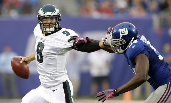 Philadelphia quarterback Nick Foles stiff arms New York Giants linebacker Mathias Kiwanuka during the Eagles' win Sunday. Foles could be back under center this week when Philadelphia plays the Tampa Bay Buccaneers.