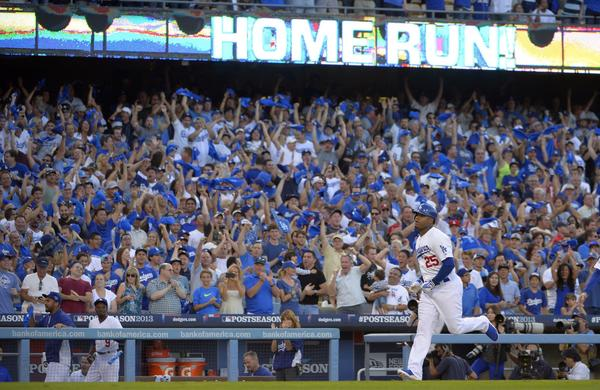 Dodgers fans celebrate a three-run home run by left fielder Carl Crawford during the Dodgers' win over the Atlanta Braves in Game 3 of the National League division series Sunday.