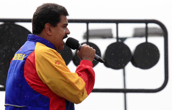 Venezuela's President Nicolas Maduro speaks during an event commemorating the one-year anniversary of the late Hugo Chavez's re-election outside Miraflores Palace in Caracas, Venezuela.