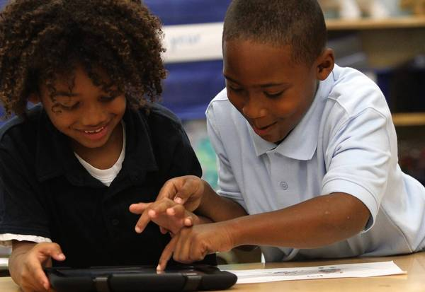 L.A. Unified students use an iPad
