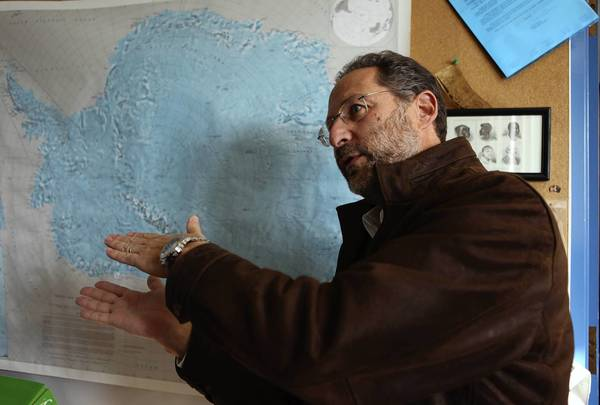Northern Illinois University geology professor Reed Scherer discusses the school's research project in front of a map of Antarctica last year.