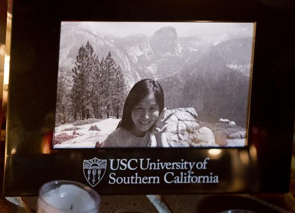 A photo of graduate student Ying Wu is shown at a candlelight memorial vigil in April 2012 at the USC campus in Los Angeles. Wu and fellow student Ming Qu were fatally shot near the campus. On Monday, a Los Angeles County Superior Court judge ruled that Bryan Barnes, 21, and Javier Bolden, 20, will stand trial for the students' murders.