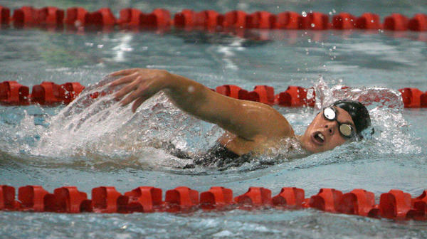 Northern State University's Ashley LaFave competes in the 200 yard freestyle event during Friday night's dual meet with the University of Minnesota-Morris at the Aberdeen Family YMCA. American News Photo File Photo by John Davis