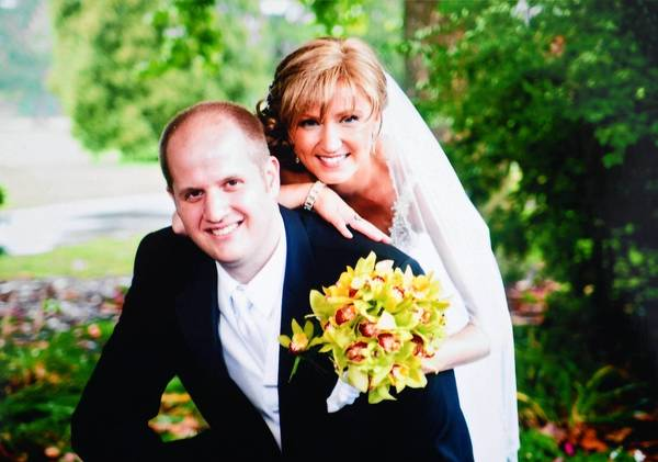 Aaron and Beata Rothrock on their wedding day on August 6, 2011. Beata was diagnosed with breast cancer while planning her wedding, and wore a wig on her wedding day because her hair was still very short from radiation treatments.