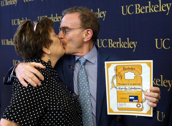 UC Berkeley professor Randy Schekman kisses his wife, Nancy Walls, during a news conference Monday announcing his place among this years recipients of the Nobel Prize in physiology or medicine.