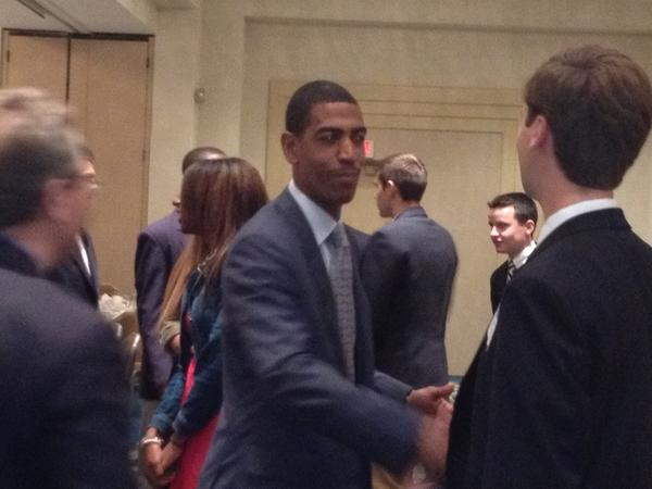 Kevin Ollie shakes hands at the Middlesex County Chamber of Commerce monthly breakfast.