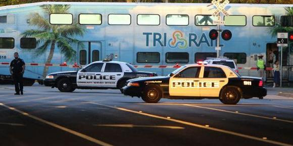 Hollywood police at the scene along Hollywood Boulevard where a woman was struck by a commuter train on Tuesday, Oct. 8, 2013.