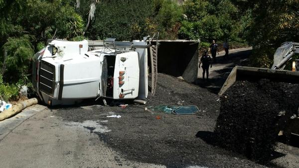 An asphalt truck overturned inside the gates of Allview Terrace on Monday.