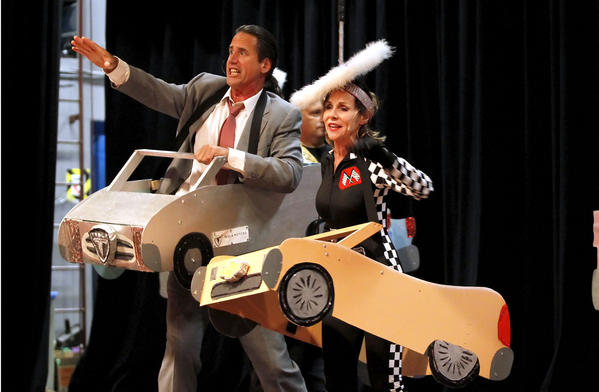 "Cast members dressed as little race cars spoof the use of the toll road in ""Toll Road"" in last year's ""Lagunatics"" production."