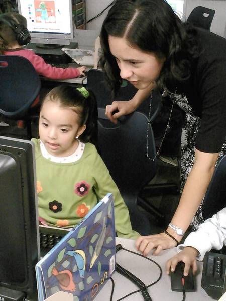 Alba Aguilar, a bilingual preschool teacher, works with Nataly Martinez, 4, at Ideal Elementary School. School officials said some of District 105's early childhood programs could be moved to a church next year to accommodate enrollment increases.