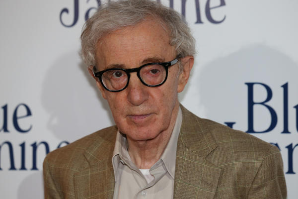 "US film director Woody Allen poses during a photocall for the French Premiere screening of ""Blue Jasmine."""