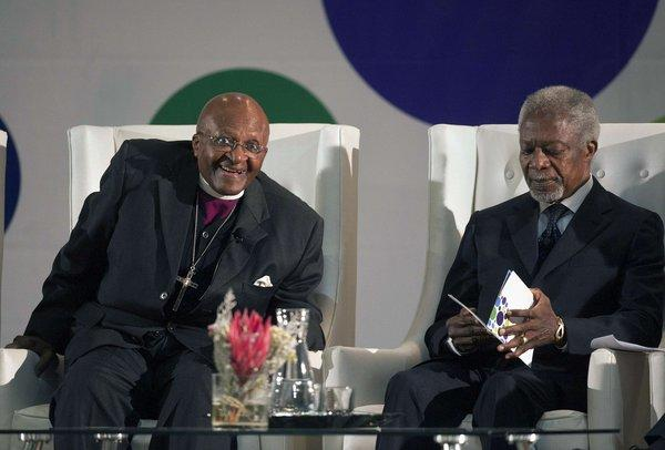 Former U.N. Secretary-General Kofi Annan, right, with Archbishop emeritus Desmond Tutu on Tuesday in Cape Town, South Africa, where Annan called on African leaders to stand by the International Criminal Court.