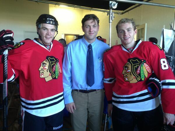 Actor Christian Madsen (center) and the Blackhawks' Andrew Shaw (left) and Patrick Kane (right) film a commercial for BMO Harris Bank in Eckhart Park Oct. 7, 2013.