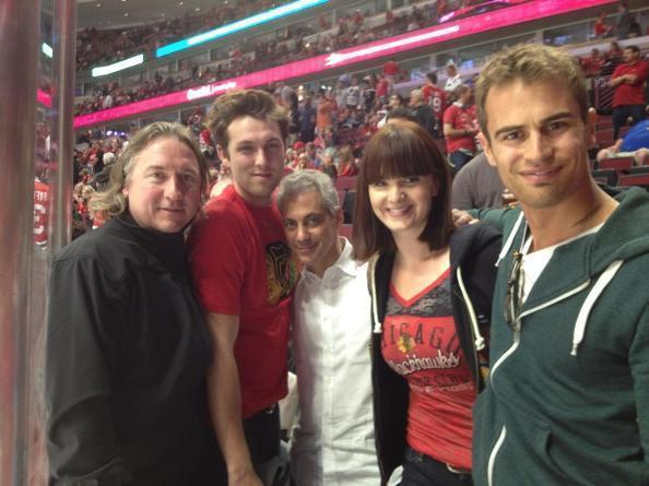 "(L to R) ""Divergent"" executive producer John Kelly, actor Christen Madsen, Mayor Rahm Emmanuel, actors Amy C. Newbold and Theo James at the Blackhawks game at the United Center June 8, 2013."