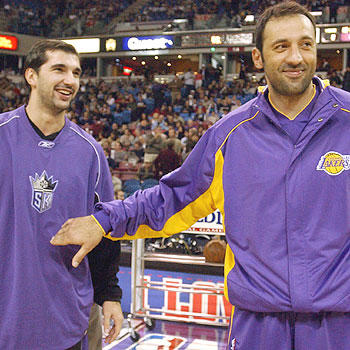 Los Angeles Lakers center Vlade Divac with Sacramento Kings forward Peja Stojakovic during pregame warmups in 2004. Divac, who played six years with the Kings, made his first appearance as a Laker since leaving the Kings prior to the 2004-05 season.