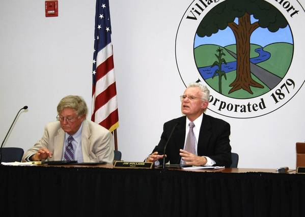Frankfort Mayor Jim Holland, right, makes a point during the Oct. 7 Village Board meeting while Trustee Dick Trevarthan looks on. Trustees awarded a $2.5 million contract to build a water tower at 80th Avenue and Steger Road. Work is expected to begin in November.