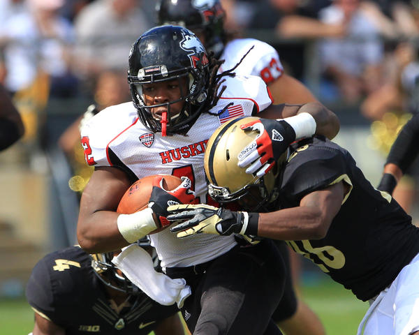 Northern Illinois Huskies running back Cameron Stingily (42) runs the ball against Purdue.