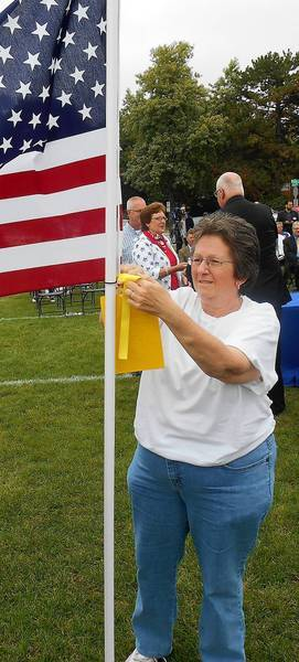 Mary Kline tagged one the Healing Field flags in honor of their son, Terry, a 1998 West Aurora graduate and F-18 Navy pilot preparing to serve on the aircraft carrier George H.W. Bush.