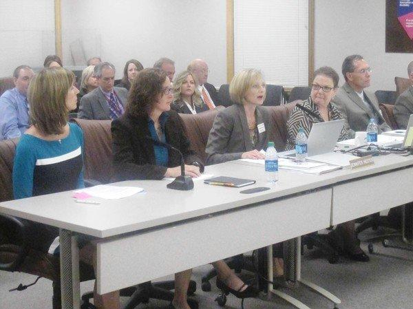 Naperville Unit District 203 kindergarten teachers Jane Sterrett, left, and Lynn Henz, Chief Academic Officer Jennifer Hester, Assistant Superintendent for Elementary Education Kitty Ryan and Chief Financial Officer Brad Cauffman discuss the all-day kindergarten program.