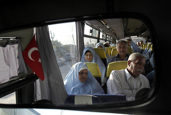 Palestinian pilgrims headed to Mecca, Saudi Arabia, wait on a bus that will take them to the Rafah border crossing between the Gaza Strip and Egypt.