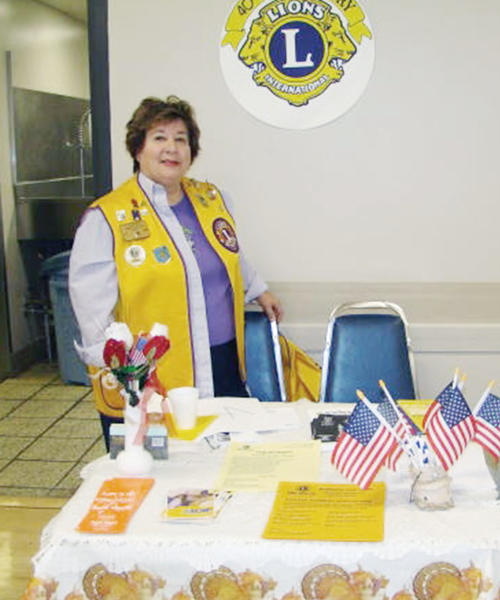 Burbank Noon Lion Brenda Lantieri stands watch over the information table at a Joslyn Adult Center Community Fair. She received a special award from her fellow club members.