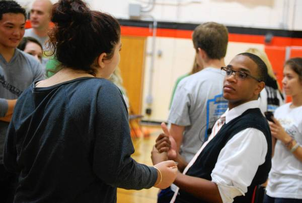 Motivational speaker and mental health advocate Jordan Burnham talks to students after his presentation at Libertyville High School.
