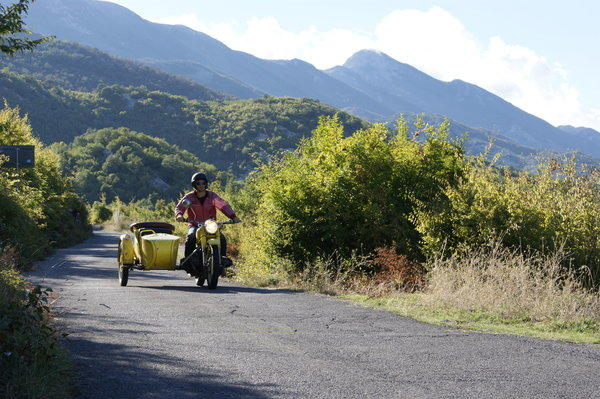 Leon Logothetis drives through Montenegro on his 1978 Chang Jiang motorcycle, refitted with a BMW 750cc engine. Along the way, strangers have paid for gas, shelter and food.