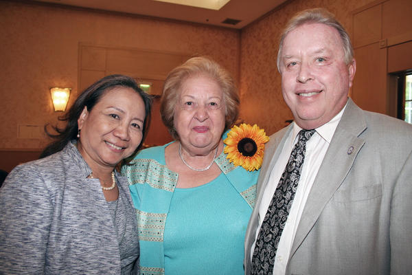 Business Life Magazine's Women Achiever Emma Salmassian (middle) is flanked by Glendale Mayor Dave Weaver and wife Linda.