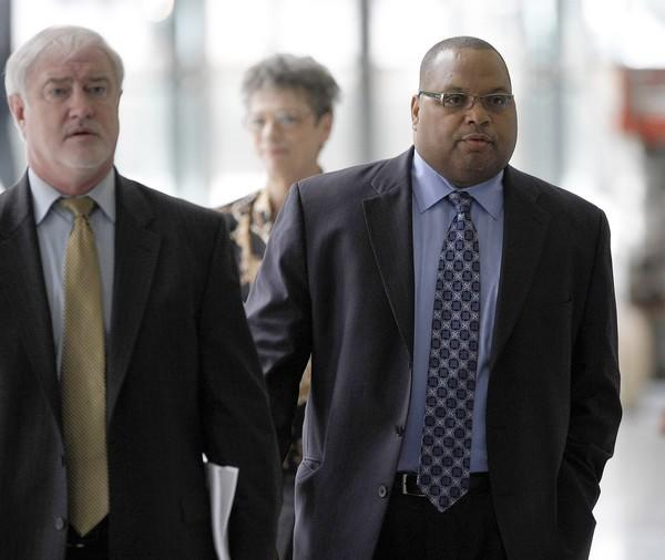 Chicago Ald. Isaac Carothers, at right, walks with his attorney, Lawrence Beaumont, at the Dirksen Federal Courthouse in Chicago on June 8, 2009. Carothers, a staunch ally of Mayor Richard Daley, pleaded guilty on Feb . 1, 2010, to federal charges he accepted about $40,000 in improvements to his residence as well as meals and tickets to sporting events in exchange for backing a major project by a developer.