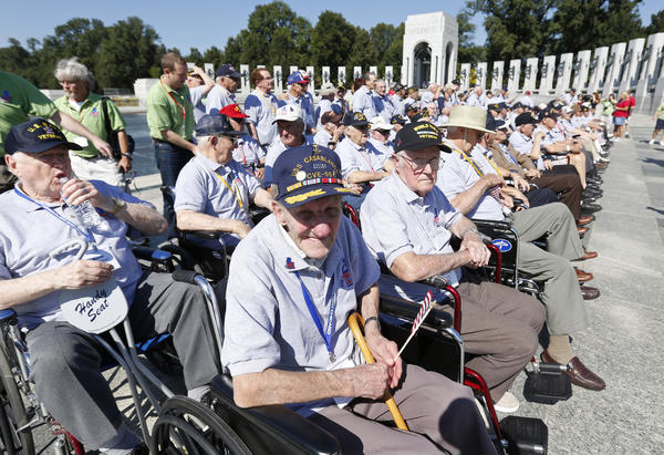 Veterans with the Heartland Honor Flight tour the World War II Memorial, which is technically closed, in Washington.