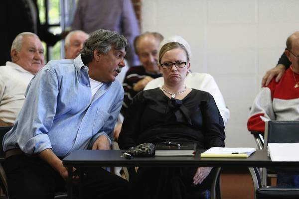 Deputy Fire Chief Ron Pieri, left, speaks with his attorney,Julie Trevarthen, as commissioners and attorneys discuss whether or not to suspend him without pay during a hearing conducted by the Board of Police and Fire Commission on Tuesday, Oct. 8, 2013 in Highwood.