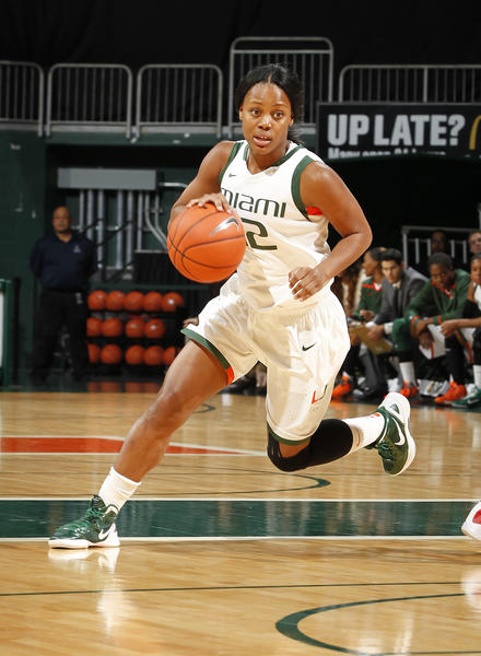 CORAL GABLES, FL - DECEMBER 8: Krystal Saunders #12 of the Miami Hurricanes brings the ball up-court against the Davidson Wildcats on December 8, 2012 at the BankUnited Center in Coral Gables, Florida. (Photo by Joel Auerbach/Getty Images)
