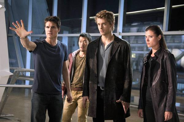 """Robbie Amell, left, Aaron Yoo, Luke Mitchell and Peyton List star in """"The Tomorrow People."""""""