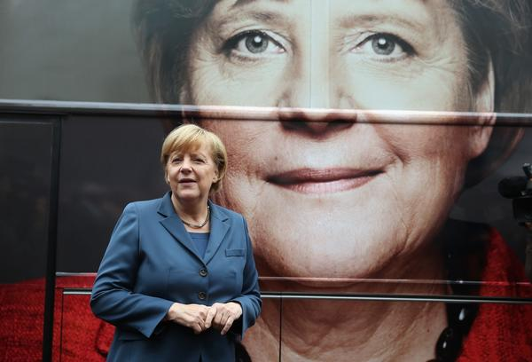 German Chancellor and Chairwoman of the German Christian Democrats (CDU) Angela Merkel poses in front of a CDU elections campaign bus outside CDU headquarters in Berlin, Germany.