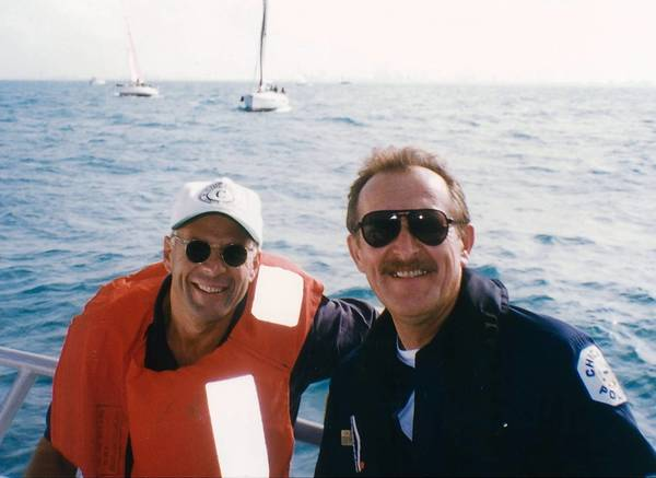 "Thomas W. Jaguszewski, right, helped with security when Bruce Willis was filming ""The Jackal"" on Lake Michigan in 1996. ""The two hit it off right away,"" Mr. Jaguszewski's wife, Sharonlee, said."