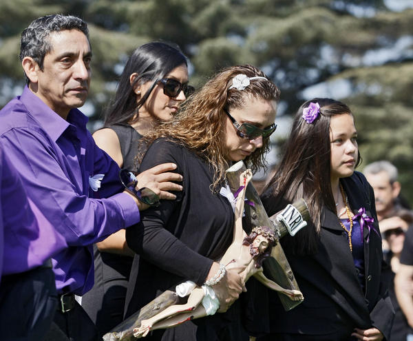 Malena Santana, center, mother to 19-year-old Burbank resident Sugey Cuevas, along with other relatives, arrive for funeral services at Pierce Brothers Vahalla in Los Angeles on Tuesday, Oct. 8, 2013. Cuevas was one of five people who died in a fiery crash in Burbank on September 28, 2013.