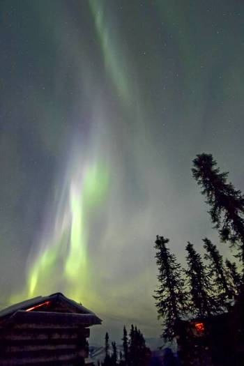 The aurora (northern lights) folds in the sky above Chena Hot Springs, north of Fairbanks, Alaska, while temperature dips to minus 45 F (minus 43C).