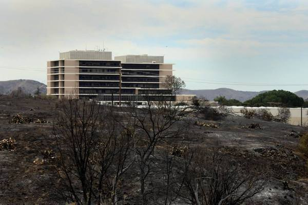 Brush fire at Camp Pendleton burned close to the base hospital. The hospital, after a power outage, was evacuated for a time.