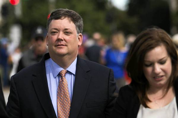 Shaun McCutcheon, the plaintiff in a case seeking to raise the limit on how much money donors can give directly to political candidates, leaves the Supreme Court building in Washington.