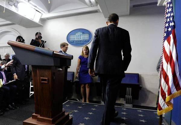 President Obama leaves a White House news conference. He cast himself as a rational player in the budget drama.