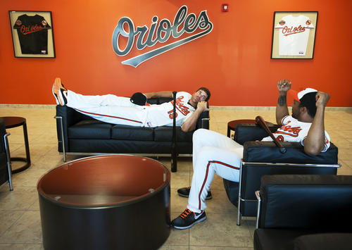 Chris Davis and Chris Dickerson lounge in the lobby of the Orioles' spring training complex waiting to have their pictures taken on photo day.