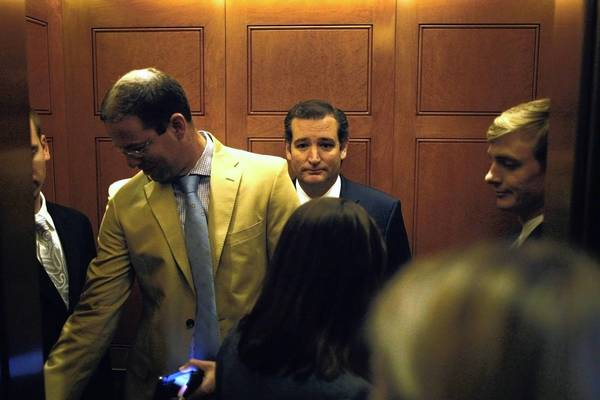 U.S. Senator Ted Cruz, center, doesn't have the back of an elevator operator's head to stare a hole into as he ponders a government shutdown.