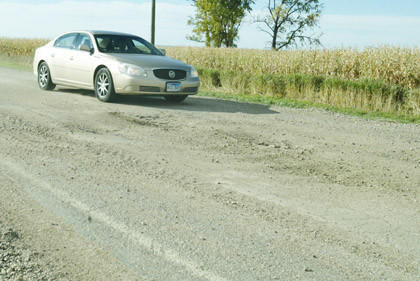 Holes like this one, on County Road 3A east of Elm Lake, has traffic slowing down and the county mulling its options for caring for the road. Residents in the area told Brown County commissioners at a Tuesday meeting that they don't want the road ground to gravel.